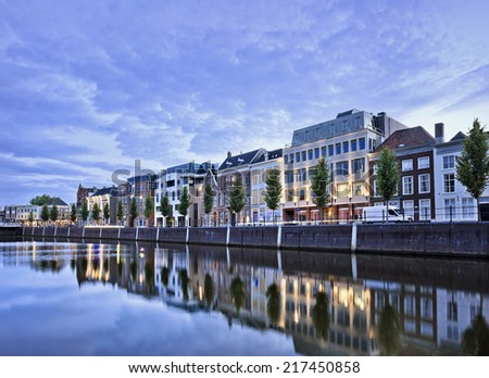 Stately mansions mirrored in a harbor at twilight, Breda, The Netherlands - stock photo
