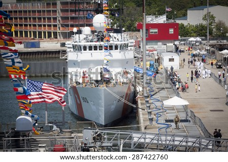 STATEN ISLAND, NY - MAY 24 2015: An overview of people walking by the USCGC Spencer (WMEC 905) a Medium endurance cutter and the Sullivans Pier during Fleet Week NY 2015. - stock photo