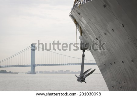 STATEN ISLAND, NY - MAY 21, 2014: The bow and anchor of the guided-missile destroyer USS Cole (DDG 067) docked during Fleet Week NY at Sullivans Piers with the Verrazano-Narrows Bridge in the background.  - stock photo