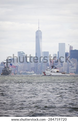 STATEN ISLAND, NY - MAY 20 2015: USCGC Spencer (WMEC 905) passes the Freedom Tower of One World Trade Center in Lower Manhattan on the Hudson River during the Parade of Ships which begins Fleet Week.