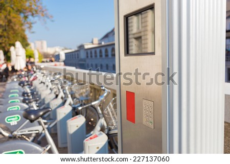Station of urban bicycles for rent downtown. Green sustainable ecological public transport. Healthy lifestyle. - stock photo