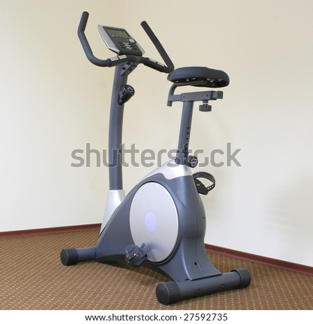 Stationary bicycle and Gym machine - stock photo