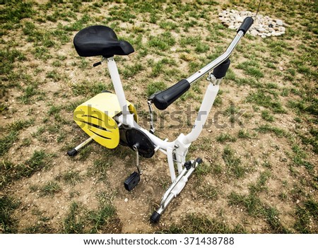 Stationary bike in outdoor space. Healthy lifestyle.