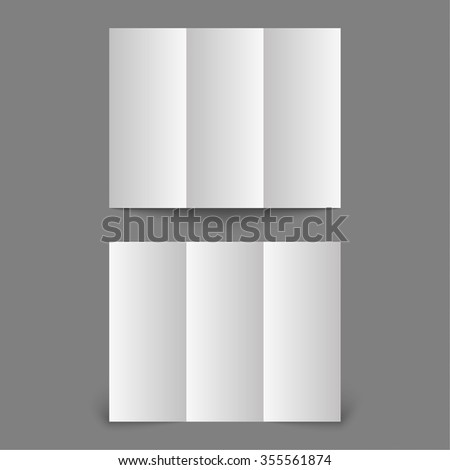 Stationary positioned blank three fold paper brochure on gray background. Open magazine. Template for design. - stock photo