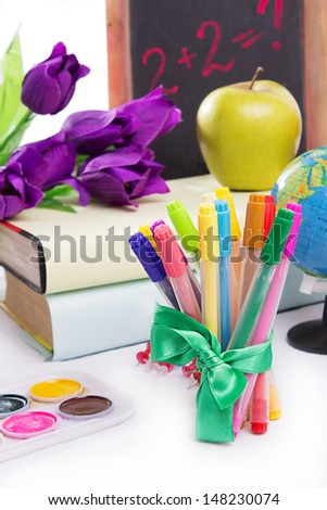 Stationary with flowers and books isolated on white - stock photo