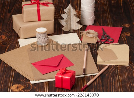 Stationery And Craft Item Set. Blank Card, Envelope. Gift Box. Wooden Background. - stock photo