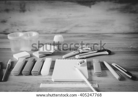 Stationery background black and white - Group of stationery tools on wood background