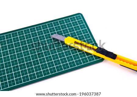 Stationery Knife Paper Cutter isolated on a white background. Concept Idea of Art and Craft.