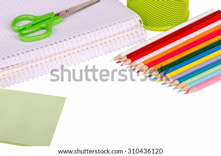 stationery, notebook, scissors, pencils isolated on a white background - stock photo