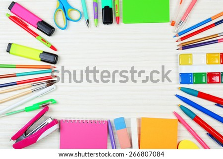 Stationery on wooden background