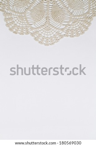 Stationery with cream colored scalloped crocheted design on white fiber paper - stock photo
