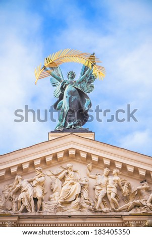 statue adorn front of Lviv State Academic Opera and Ballet Theatre. Theatre (1897 - 1900) was built in classical tradition of Renaissance and Baroque architecture. Ukraine - stock photo
