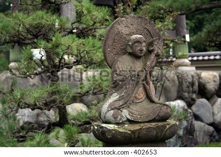 Statue at a Buddhist Temple in the outskirts of Tokyo, Japan - stock photo