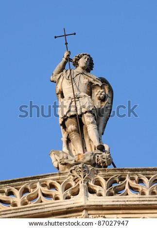 Statue at Aix Cathedral - Cathedrale Saint-Sauveur d'Aix - in Aix-en-Provence city, France - stock photo