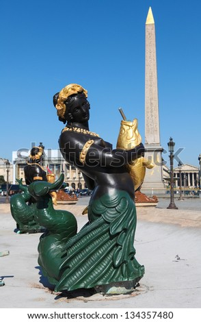 Statue at La Fontaine des Fleuves (1835) in front of the Luxor obelisk at the Place de la Concorde, the largest public square in Paris, France. - stock photo