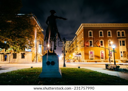 Statue at night in Mount Vernon, Baltimore, Maryland. - stock photo