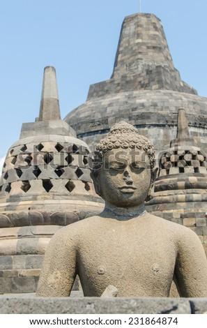 Statue at the Borobudur temple in Yogyakarta, Indonesia - stock photo