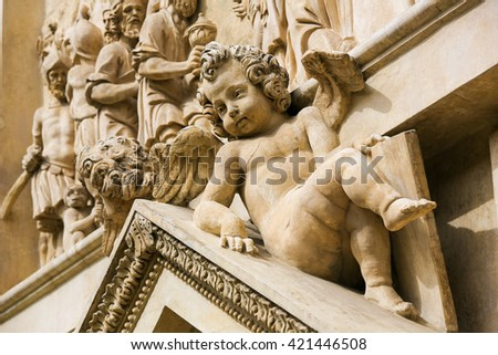 Statue at the Santa Casa of Loreta, a large pilgrimage site in Hradcany, Prague, of an angel. - stock photo