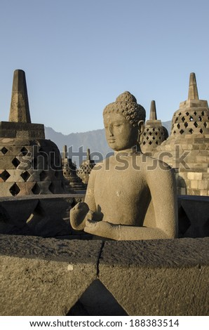 Statue Buddha, Borobudur, Java. Mahayana Buddhist Temple, Central Java. The monument decorated with relief panels and Buddha statues - stock photo
