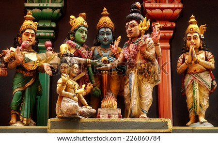 Statue depicting a scene from the Wedding of the lords according to the Indian tradition,customs and cultural values taken at a temple in Bangalore,India - stock photo