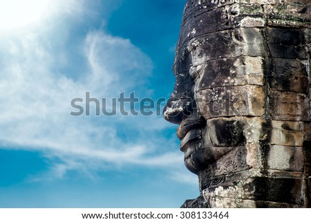 Statue in a temple in Cambodia against the sky - stock photo