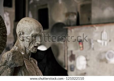 Statue in sculptor workshop closeup photo - stock photo