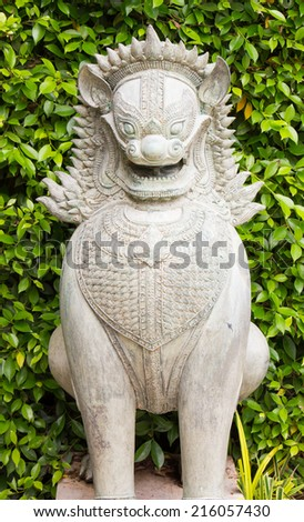 statue in stone of a dog - stock photo