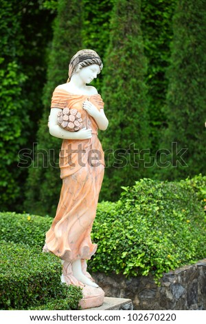 Statue lady in the garden - stock photo