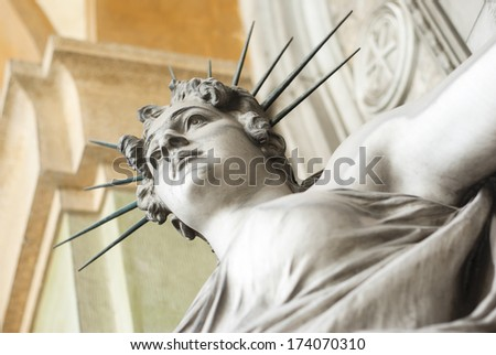 statue lady with aureole - stock photo