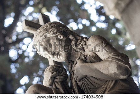 statue lady with cross - stock photo
