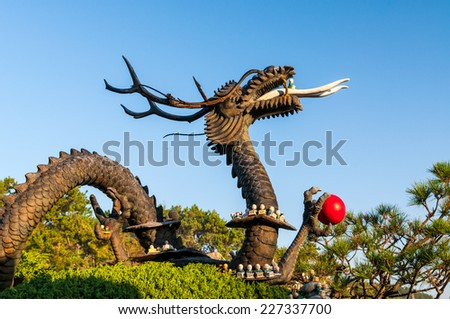 Statue of a dragon at Haedong Yonggungsa Temple in Busan, South Korea. - stock photo