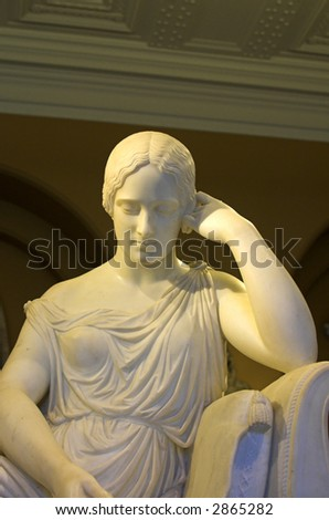 Statue of a Girl at Victoria and Albert Museum, South Kensington London - stock photo