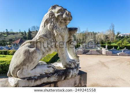 Statue of a lion near the royal castle. Sintra Queluz. - stock photo