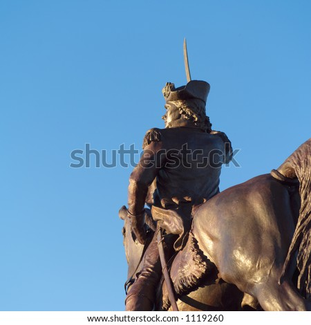 Statue of a man riding on a horse