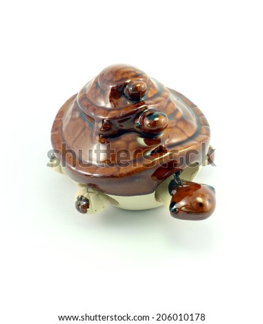 Statue of a turtle on white background. - stock photo