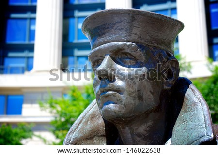 Statue of a United States Navy man staring into the distance at the memorial in Washington DC. - stock photo