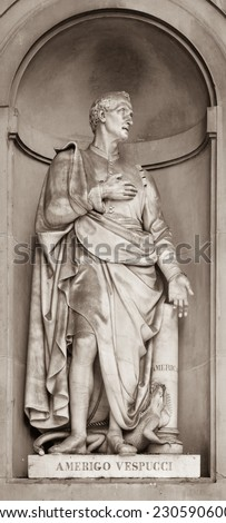 Statue of Amerigo Vespucci in the niches of the Uffizi Gallery colonnade, Florence. - stock photo