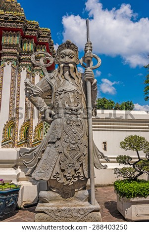 Statue of an ancient chinese warrior outside a temple in Bangkok, Thailand - stock photo