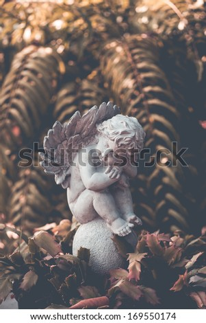 Statue of an angel in a garden - stock photo
