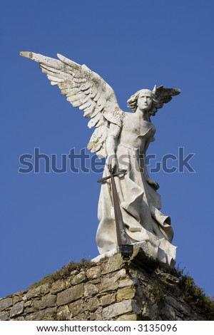 Statue of an angel made of stone from a cemetery in Cantabria, Spain. - stock photo