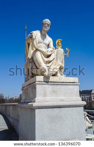 Statue of Austrian Parliament Building - stock photo