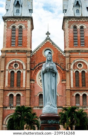 Statue of blessed virgin Mary outside of the church - stock photo