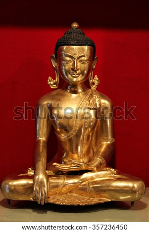 Statue of Buddha in a temple. - stock photo