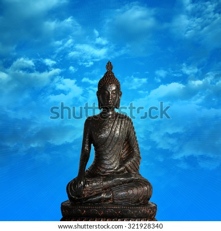 statue of buddha with blue sky and couds background - stock photo