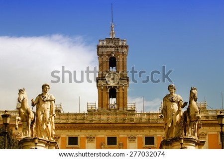 Statue of Castor and Pollux at the Cordonata stairs, Statues of the Dioscuri on Piazza del Campidoglio in Rome, Italy - stock photo