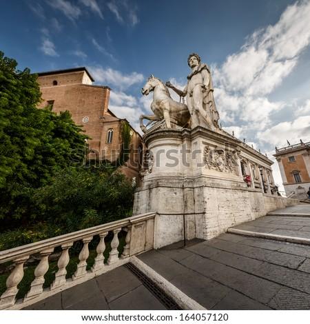 Statue of Castor at the Cordonata Stairs to the Piazza del Campidoglio Square at the Capitoline Hill, Rome, Italy - stock photo