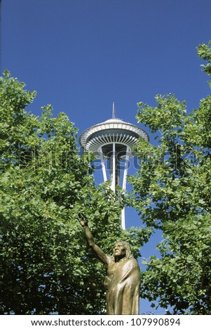 Statue of Chief Seattle in front of the Space Needle, Seattle, Washington. - stock photo