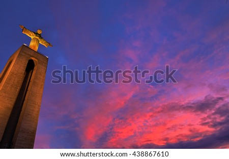 Statue of Christ the King in Lisbon at sunset - stock photo