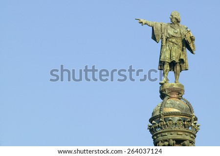 Statue of Christopher Columbus points west to New World, next to waterfront of Port Vell, Barcelona, Spain - stock photo
