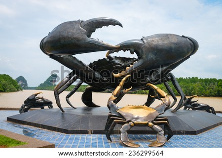 Statue of crabs in Krabi, symbol of the town, with Khao Kanab Nam cliff on background. Thailand  - stock photo